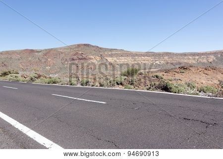 empty highway in desert landscape summer , blue sky