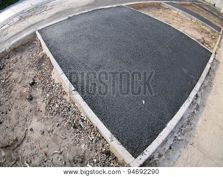 The Fresh, Black, Just Laid Asphalt At The Construction Site