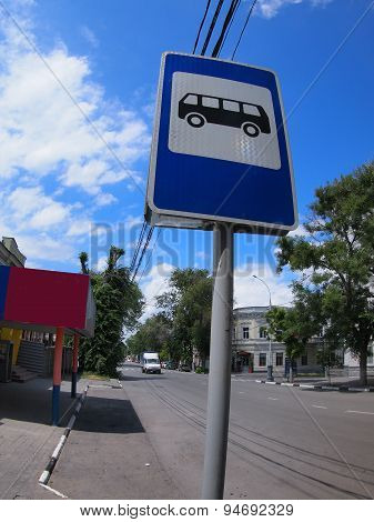 Road Sign With A Picture Of A Bus Stop On A City Street