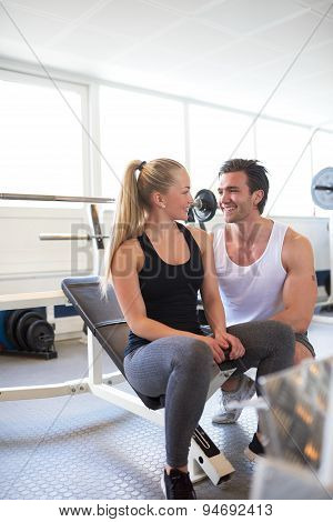 Couple Flirting With Each Other At Gym