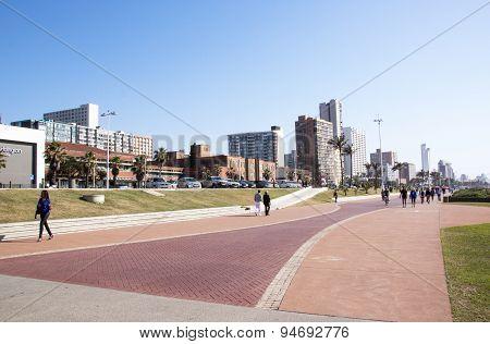 People On Promenade Against Durban City Skyline
