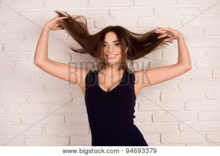 Beautiful Girl Smiling And Throws Her Hair
