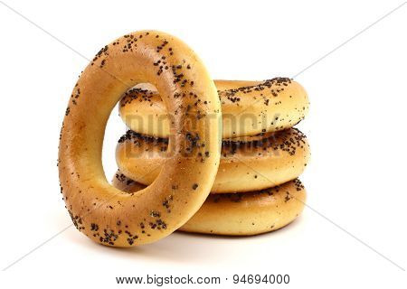 Four Bagels With Poppy Seeds