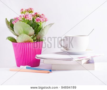 Workplace with flower books and a coffee cup