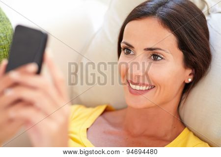 Beautiful Young Woman Using A Smart Phone