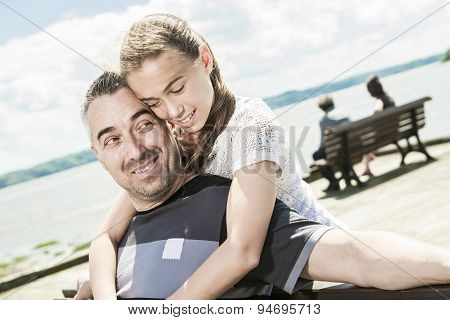 Father with his daughter at sea getting good time