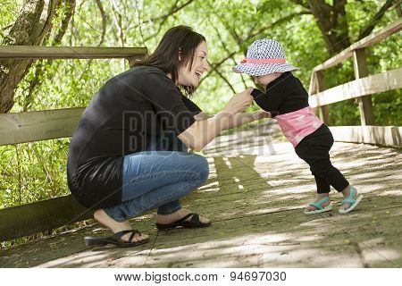 Mother and daughter in forest