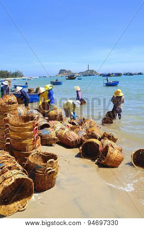 Lagi, Vietnam - February 26, 2012: Local Women Are Cleaning Their Baskets Which Were Used For Transp