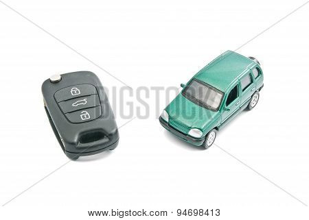 Green Car And Car Keys With Alarm