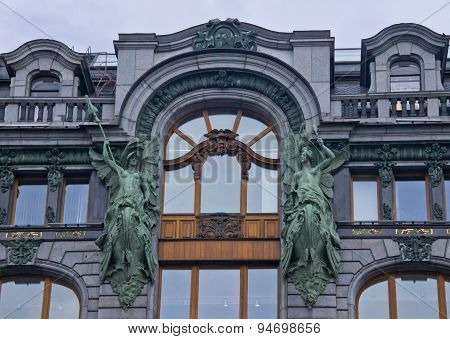 Beautiful Gray Building With Two Statues