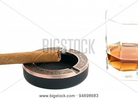 Cigar In Metal Ashtray And Glass Of Whiskey