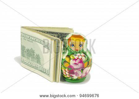 Russian Babushka Dolls With Dollar Bills Isolated