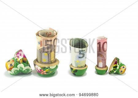 Russian Babushka  Dolls With Euro Bills Isolated