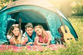 stock photo of threesome  - Group of best friends with thumbs up having fun camping together  - JPG