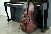 stock photo of cello  - Cello near piano - JPG