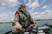 picture of life-boat  - man dressed in a life jacket operates a motor boat - JPG