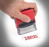 pic of denied  - Plastic stamp in hand isolated on white  - JPG