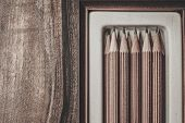 picture of charcoal  - Luxurious charcoal drawing pencils on a wooden table  - JPG