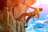picture of climbing wall  - rock climber climbs on a rocky wall - JPG