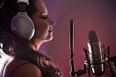 stock photo of singer  - Young singer screaming on the studio microphone - JPG