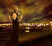 picture of evening gown  - Woman Evening Dress Posing on City Night Lights Fashion Model in Long Gown Back Rear View Looking to Side urban nightlife - JPG