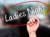 foto of ladies night  - Man Hand writing Ladies Night with black marker on visual screen - JPG