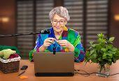 image of knitting  - Retired woman has registered in online knitting group - JPG