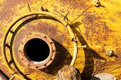 pic of manhole  - opened rusty manhole on red fuel tank - JPG