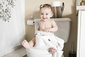pic of disobedient  - A Toddler ripping up toilet paper in bathroom - JPG