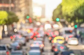 picture of transportation icons  - Rush hour with defocused cars and generic vehicles  - JPG