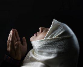 stock photo of muslim  - Muslim woman praying - JPG