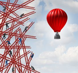 picture of climb up  - New strategy and independent thinker symbol and new innovative thinking leadership concept or individuality as a group of people climbing ladders in confusing directions with one team of employees in a red balloon going up in a clear direction - JPG