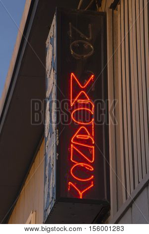 Close up of a red lit up neon No Vacancy sign showing there is a vacancy