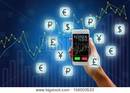 Forex concept stock market Woman holding smart phone and currency icon and chart background.