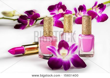 Nail polish, lipstick and flowers