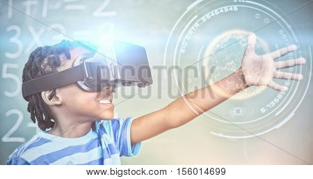 Digitally generated image of planet with light trail against school boy in virtual reality glasses in classroom