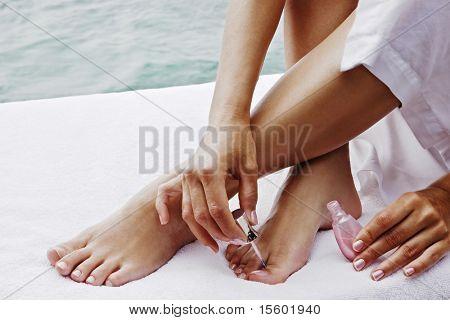 Closeup de manos y pies femeninos. Tratamiento de belleza