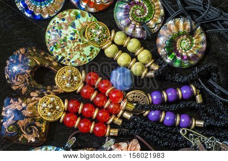 bead chaplet beading. a small piece of glass stone or similar material typically rounded and perforated for threading with others as a necklace