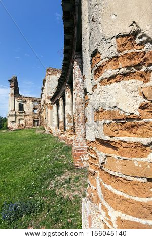 ruins of an ancient palace of the 16th century, against the blue sky, located in the village Ruzhany, the territory of the Republic of Belarus. The building is constructed of red brick