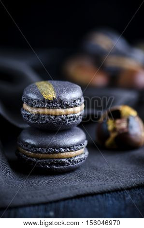 Black macaron with chesnut ganache and caramel