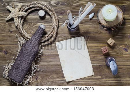 The concept of writing a letter on a ship travel sea adventures top view. Vintage writing set feather quill ink desk and blank antique paper flat lay.