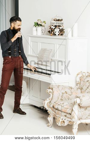 Handsome Man Singing Near Piano