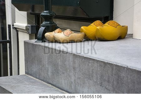 Two pair of yellow dutch clogs on the street