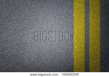 Asphalt road texture yellow line on road