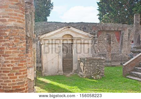 The Purgatorium of Temple of Isis surrounded by stone columns and ruined walls Pompeii Italy.