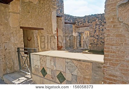 The open air ancient Thermopolium (restaurant or cafe) with the marble counter Pompeii Italy.