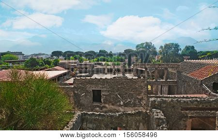The view on ancient Pompeii mostly destroyed and buried under ash and pumice in eruption of Mount Vesuvius Italy.