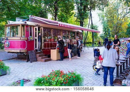 KIEV UKRAINE - SEPTEMBER 18 2016: The retro tram became the stylish student cafe it's located in Taras Shevchenko park next to the National University on September 18 in Kiev.