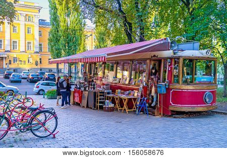 KIEV UKRAINE - SEPTEMBER 18 2016: The retro tram had found a new life as the stylish student cafe in park next to the Taras Shevchenko National University on September 18 in Kiev.