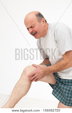 Man Rubs Sore Knee. Cry Because Of Pain